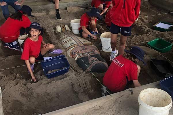 Kids digging at an Egyptian Dig