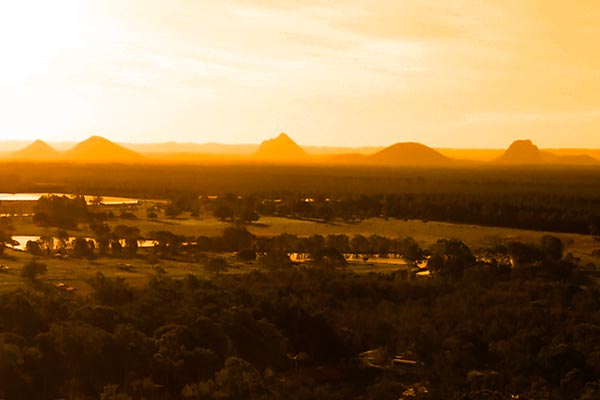 glasshouse mountains from the Abbey Museum by drone shot