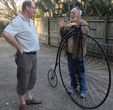 Michael Strong with the donor of a penny farthing bicycle