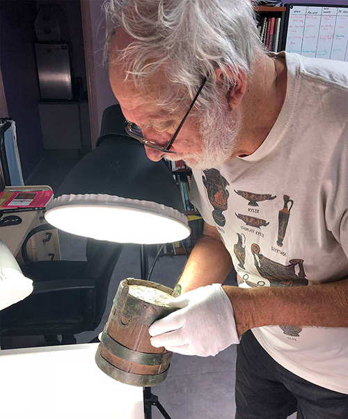 Senior Curator Michael Strong with Anglo Saxon Funerary bucket