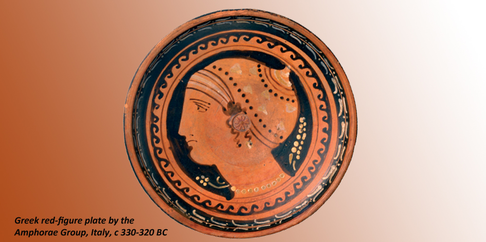 RED FIGURE WARE PLATE DECORATED WITH WOMANS HEAD